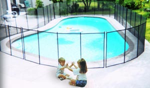 Kids Sitting in Front of Pool Fence